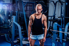 Fit man standing in the gym. And looking to the camera Stock Images