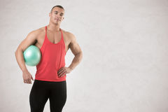 Fit Man Standing Holding a Pilates Ball Stock Photography