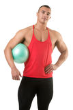 Fit Man Standing Holding a Pilates Ball Royalty Free Stock Photo