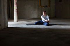 Fit man stretching in dark space Royalty Free Stock Photos