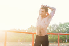 Fit man stretching his arm and shoulder warming up on fresh air. Stock Images