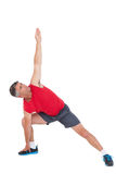 Fit man stretching his legs and arms Stock Photography