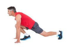 Fit man stretching his legs Stock Photo