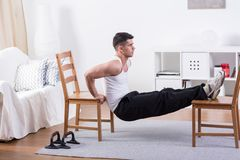 Fit man stretching at home Stock Photos