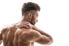 Fit man suffers from neckache Royalty Free Stock Image