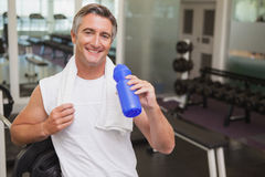 Fit man taking a break in the weights room Stock Images