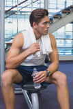 Fit man taking a break from working out Royalty Free Stock Images