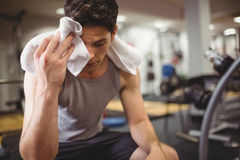 Fit man taking a break from working out. At the gym stock image