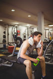 Fit man taking a break from working out. At the gym stock photography