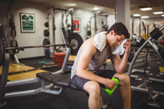 Fit man taking a break from working out. At the gym royalty free stock images
