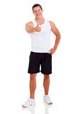 Fit man thumb up. Happy fit young man giving thumb up isolated on white background Royalty Free Stock Photography