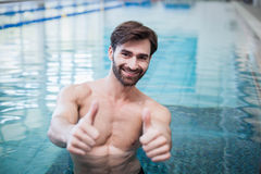 Fit man with thumbs up Stock Photo