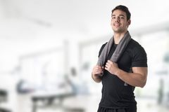 Fit Man With a Towel on His Neck Stock Photos