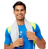 Fit Man With Towel And Water Bottle. Portrait of confident fit man with towel and water bottle against white background. Horizontal shot royalty free stock image