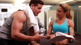 Fit man and trainer talking about his progress Stock Photos