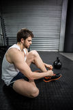 Fit man tying his shoelaces Stock Images