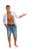 Fit Man In Unbuttoned Shirt Presenting Something Royalty Free Stock Images