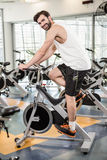 Fit man using exercise bike Stock Image