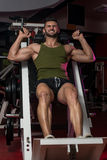 Fit Man Using The Leg Press Machine At A Health Club Royalty Free Stock Image