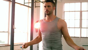 Fit man using skipping rope stock footage