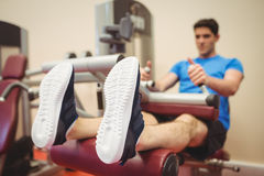 Fit man using weights machine for legs Stock Images