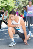 Fit man warming up before race. Fit men warming up before race on a sunny day Stock Image