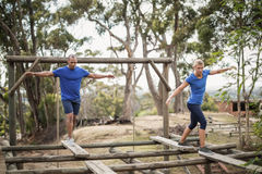Fit man and woman during obstacle course training. Fit men and women during obstacle course training at boot camp stock image