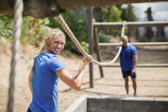 Fit man and woman practicing during obstacle course Stock Images