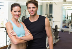 Fit man and woman smiling at camera together Royalty Free Stock Photography
