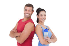 Fit man and woman smiling at camera together. Fit men and women smiling at camera together on white background stock photography