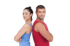 Fit man and woman smiling at camera together Royalty Free Stock Image