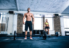 Fit man and woman workout at gym Stock Photography