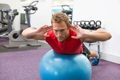 Fit man working his core on exercise ball Stock Image