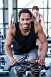 Fit man working out at spinning class Stock Images