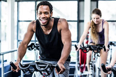 Fit man working out at spinning class Royalty Free Stock Images