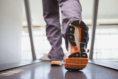 Fit man working out on treadmill Stock Images
