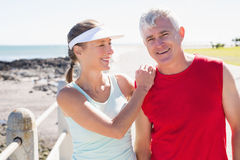 Fit mature couple warming up together on the pier Royalty Free Stock Photo