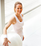 Fit mature female holding  a fitness ball Stock Image