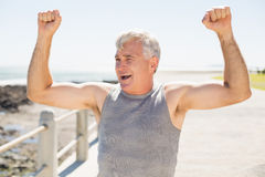 Fit mature man cheering on the pier Royalty Free Stock Photography