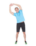 Fit mature man exercising against white background Stock Photo