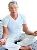 Fit mature man practicing yoga Royalty Free Stock Photo