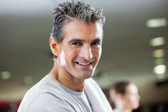 Fit Mature Man Smiling. Closeup of portrait of mature man smiling at health club stock photography