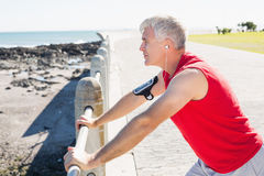 Fit mature man warming up on the pier Stock Photos