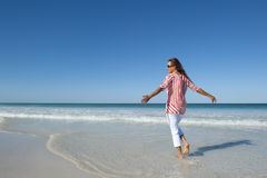 Fit and mature woman on beach Royalty Free Stock Photo