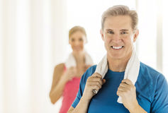 Fit Mature Woman Holding Towel Around Neck At Home Royalty Free Stock Photography