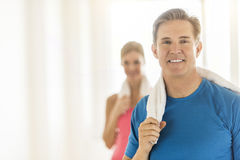 Fit Mature Woman Holding Towel With Woman In Background Royalty Free Stock Photos