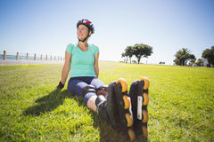 Fit mature woman in roller blades on the grass Stock Photo