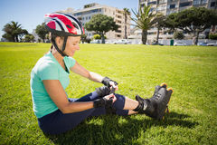 Fit mature woman in roller blades on the grass Stock Image
