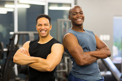 Fit men. With arms crossed in gym Royalty Free Stock Image