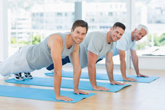 Fit men doing push ups at gym Royalty Free Stock Images